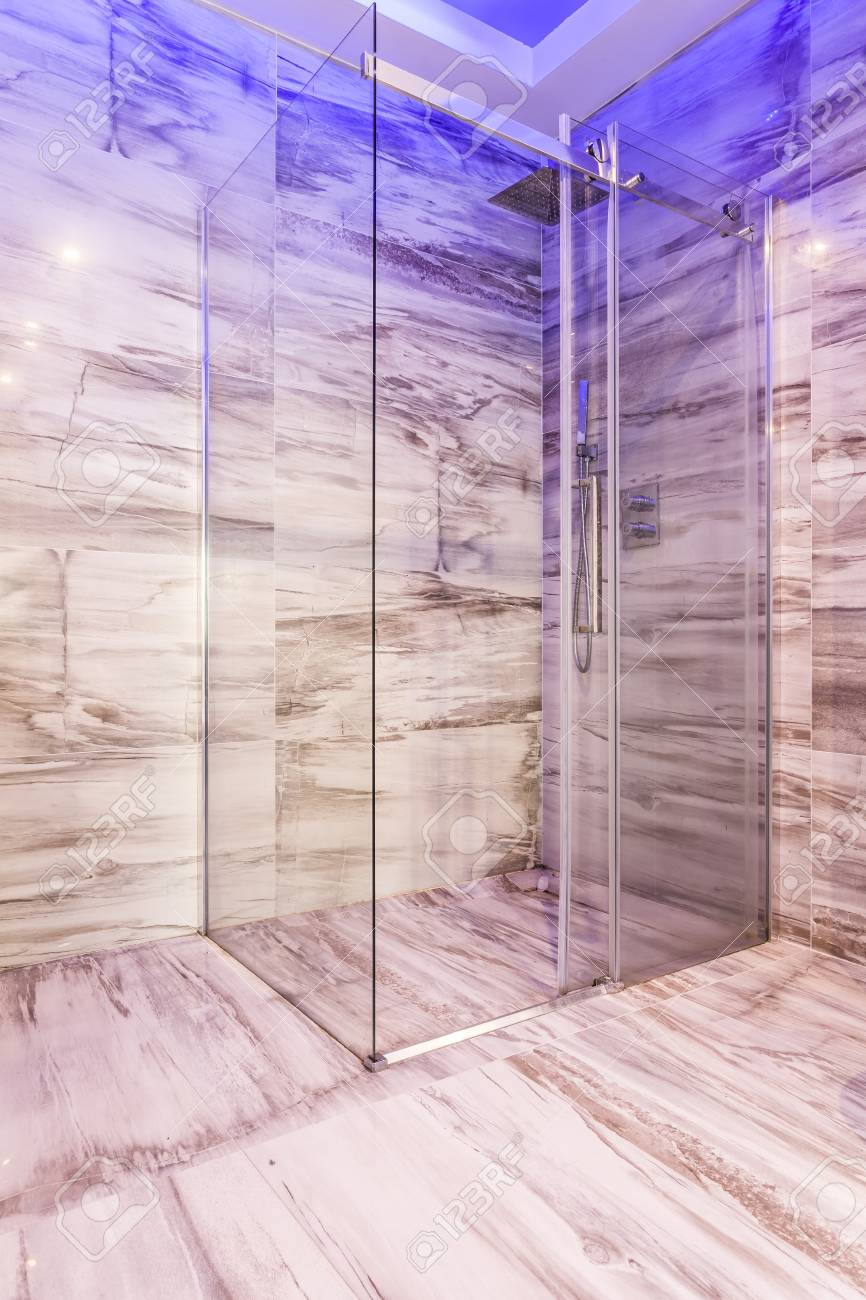shower stall lighting. Stock Photo - Transparent Glass Shower Stall With Blue Lighting In Marble Bathroom