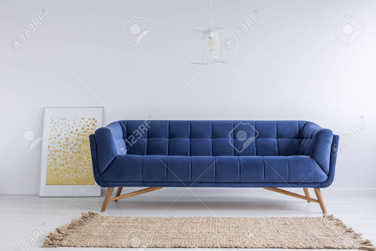 Simple White Room With Blue Sofa And Rug Stock Photo Picture And