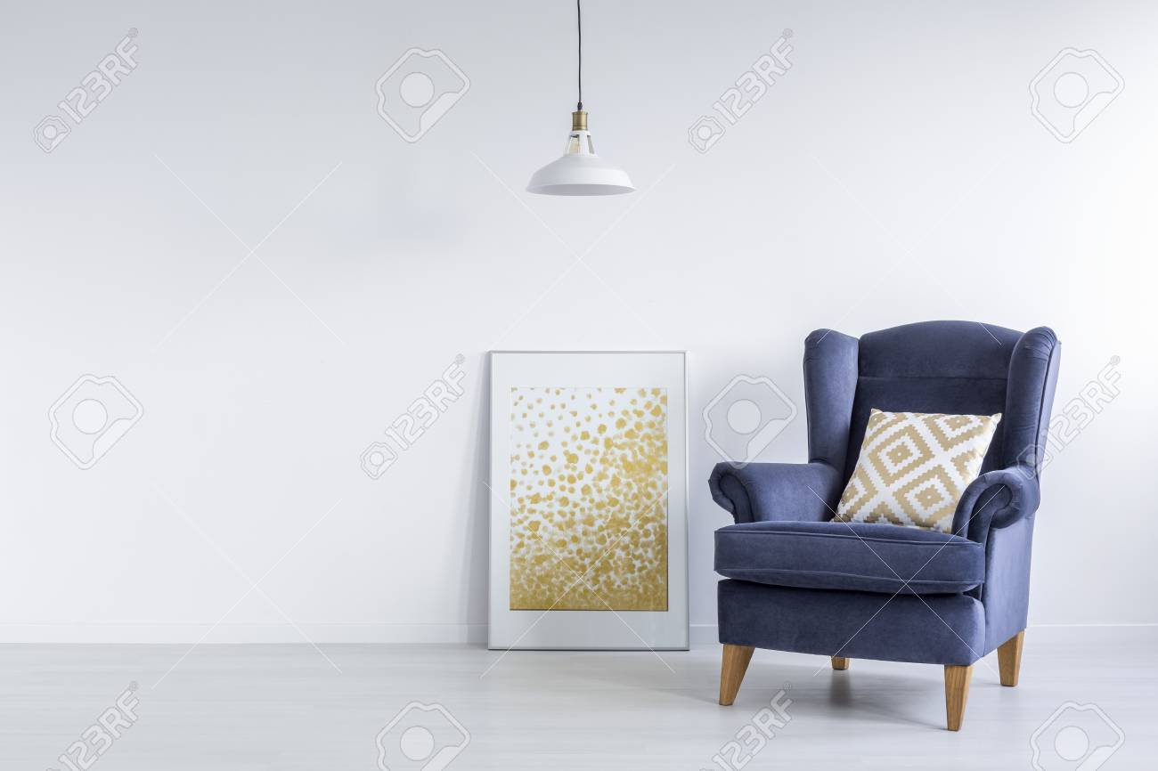 Bright Interior With Modern Wall Poster, Lamp And Blue Armchair Stock Photo    71340116