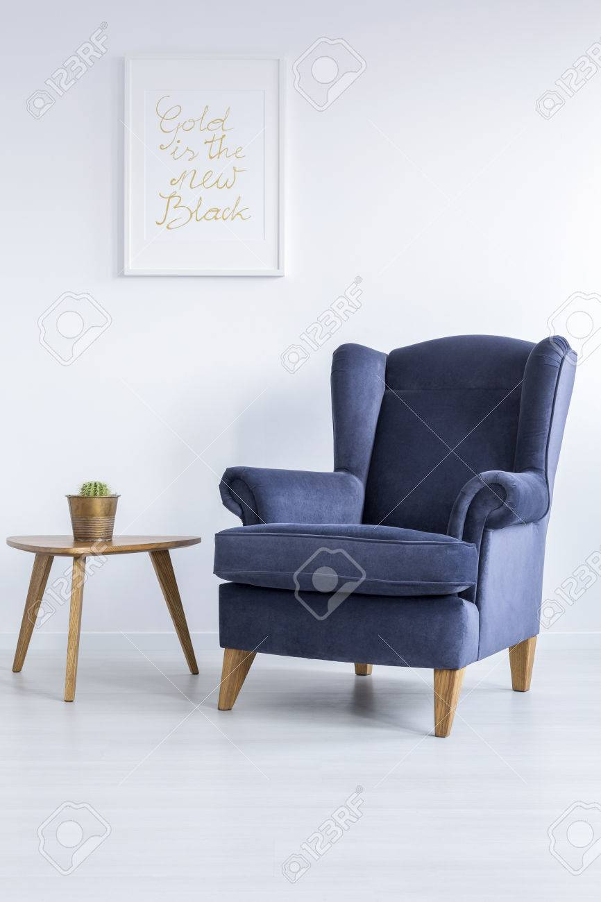 White Room With Blue Upholstered Armchair And Side Table Stock Photo ...