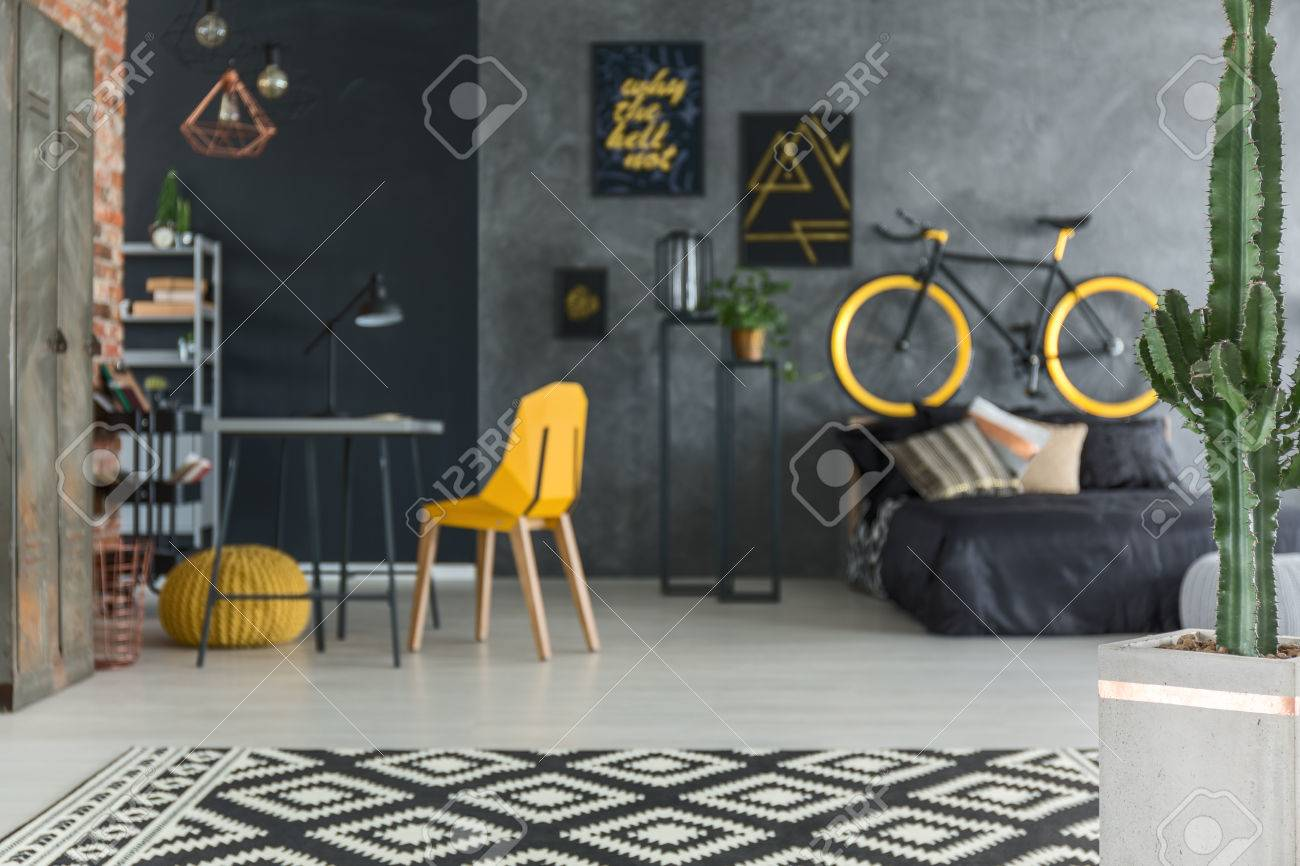 Grey Hipster Room With Bed, Bike, Yellow Chair And Desk Stock Photo    71340238