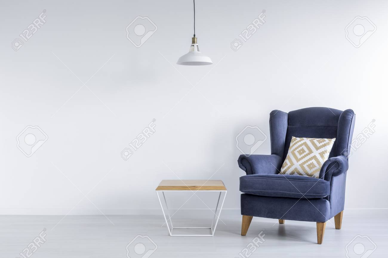 the latest 6c939 b4304 Ascetic room with blue armchair, side table and white lamp