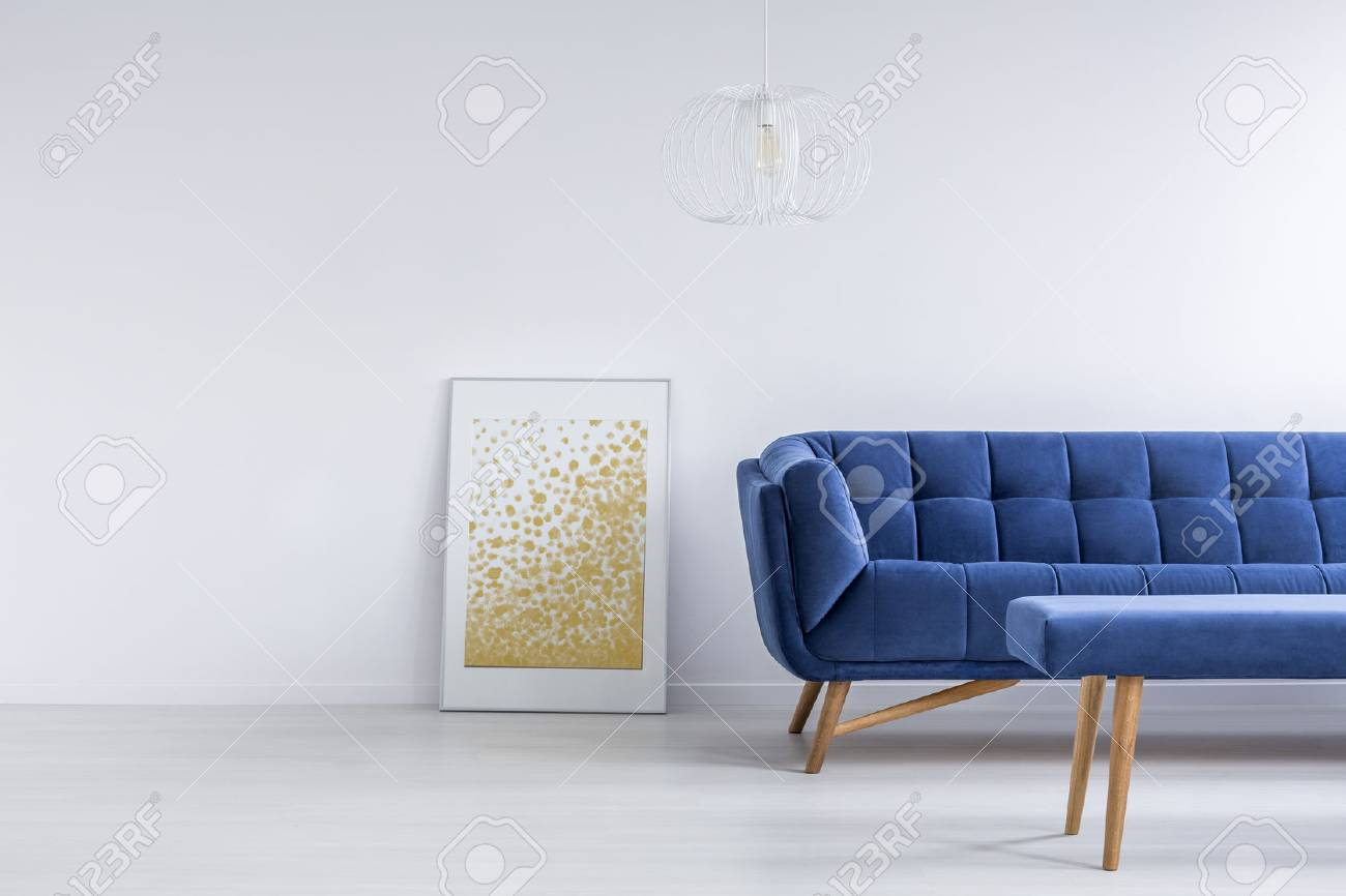 White Living Room With Blue Sofa, Bench And Wall Poster Stock Photo ...