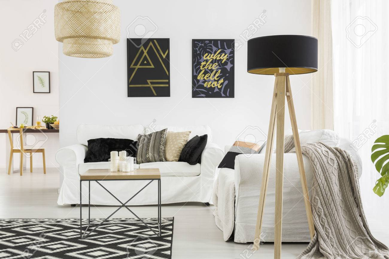 Trendy Living Room With White Sofa, Black Lamp And Table Stock Photo ...