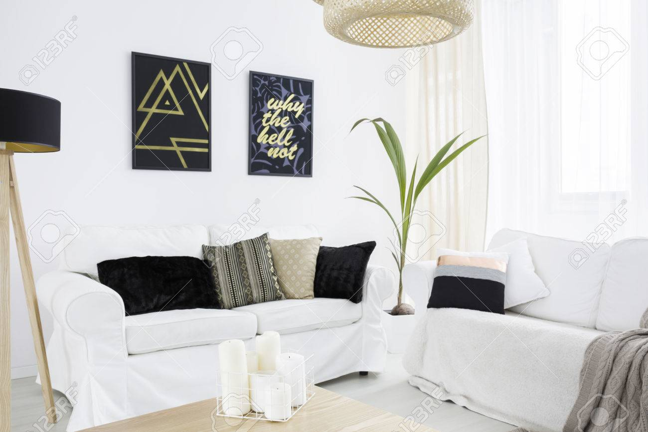 New Living Room With White Couch, Black Lamp And Pillows Stock Photo ...