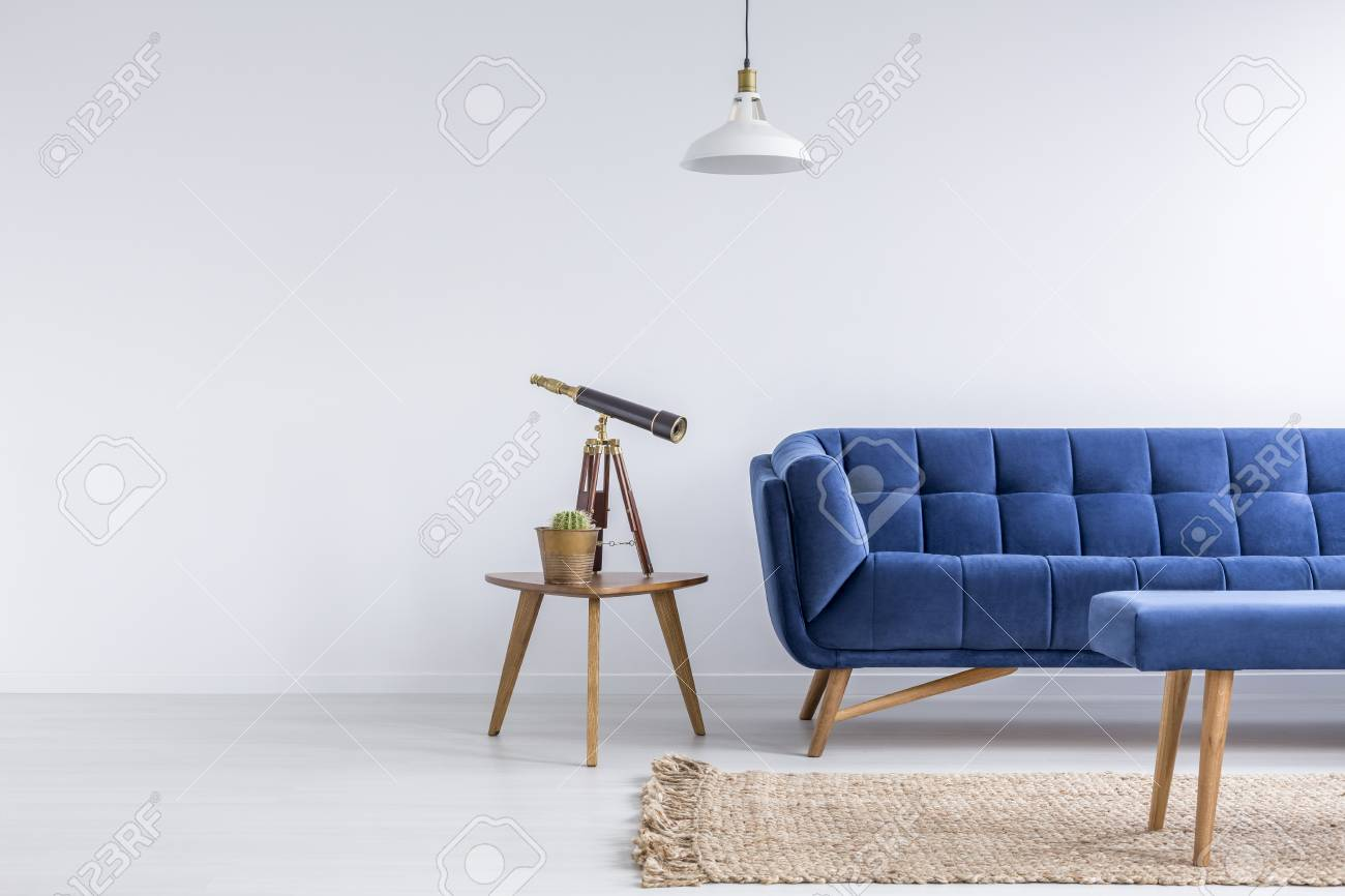 Bright Apartment With Blue Sofa Bench Rug Lamp And Table Stock