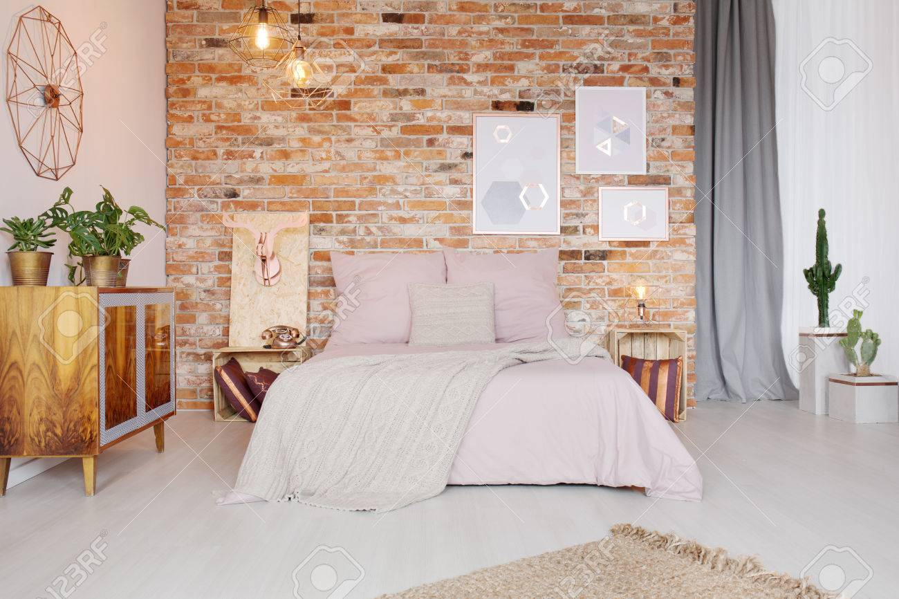 Bedroom With Pallet Side Table And Double Bed Stock Photo