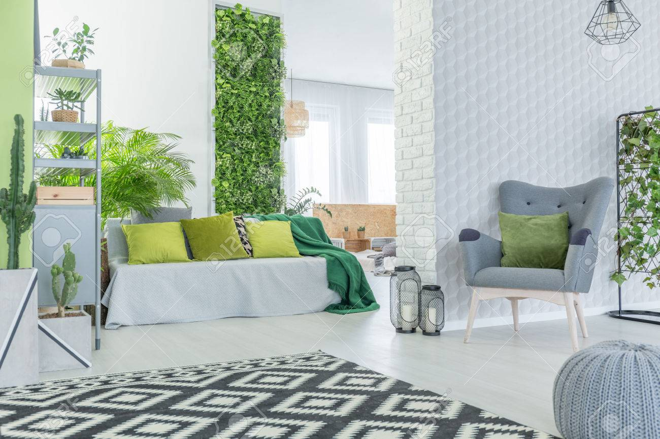 Modern Apartment With 3d Wallpaper, Sofa, Armchair And Pouf Stock ...
