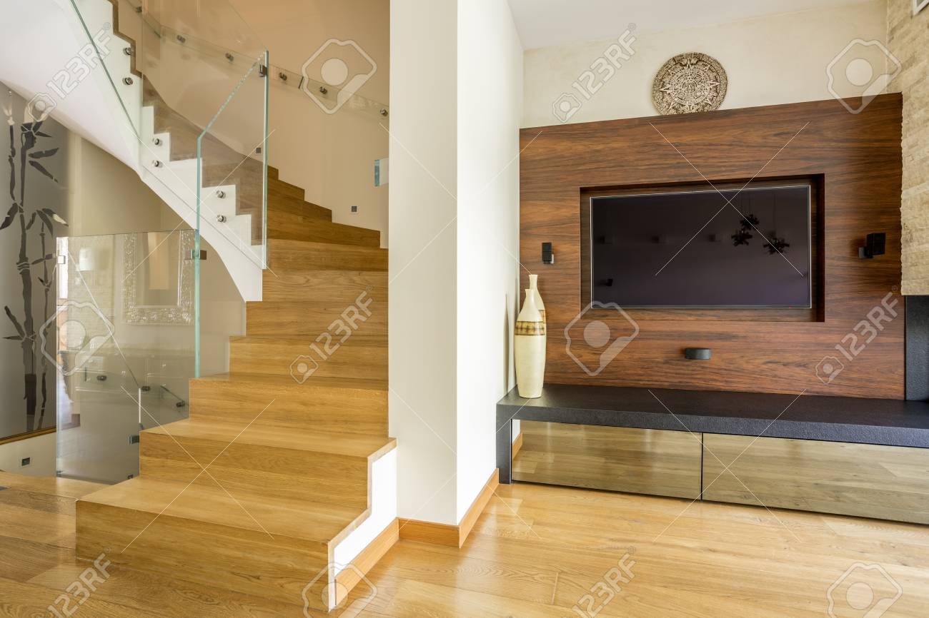 Spiral Wooden Stairs In Big Stylish Lounge With Television Stock ...