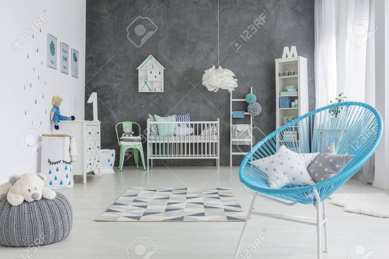 Grey And White Baby Room With Round Chair And Cot Stock Photo ...