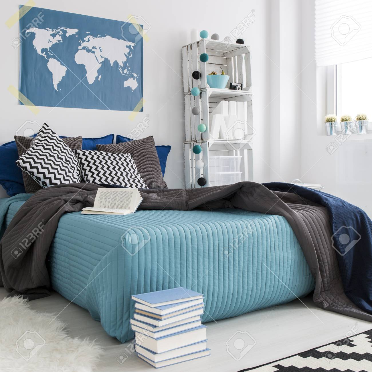 Modern cozy bedroom with double bed with blue bedding diy hipster modern cozy bedroom with double bed with blue bedding diy hipster bookcase and world map gumiabroncs Image collections