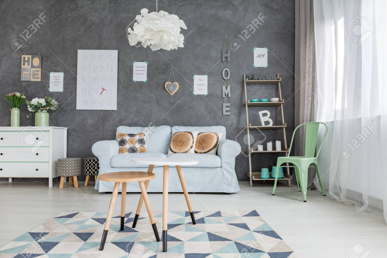 Light And Cosy Room With Letters Hanging On The Wall