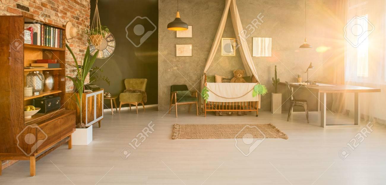 Spacious Room Interior With A Bookshelf Baby Crib And Big Desk Stock Photo