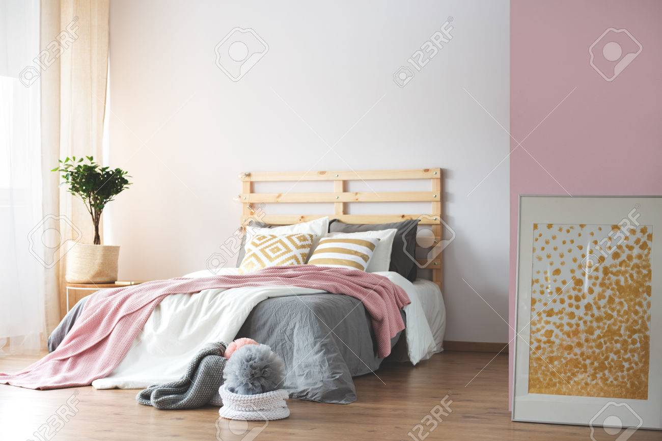 Cozy pink and white bedroom with grey accessories
