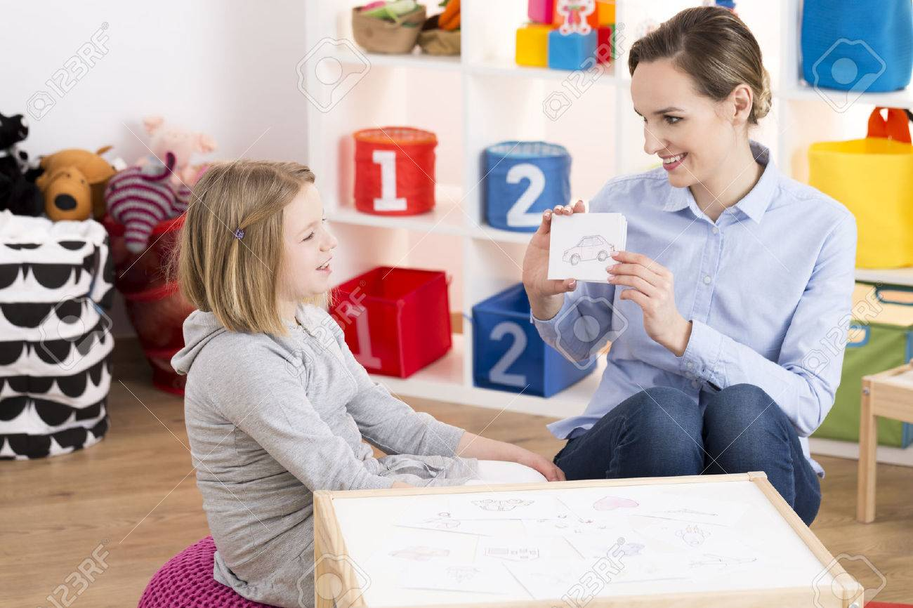 Little blond girl visiting professional speech therapist Stock Photo - 75795037