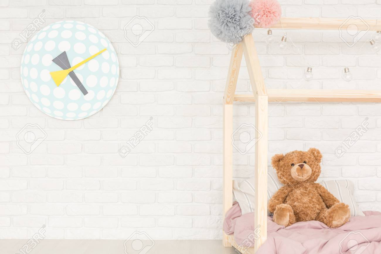 White Child Room With Decorative Wall Clock Bed Teddy Bear Stock