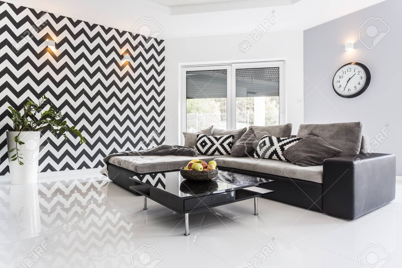 Posh Living Room With White Tiled Floor And Black Lounge Set Stock ...