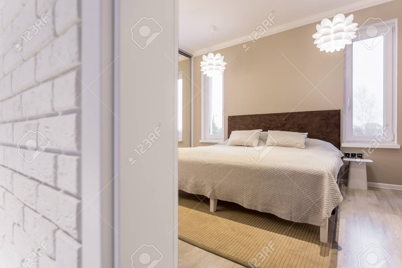 Big White Bed With Wooden Headboard In Modern Bedroom Stock Photo Picture And Royalty Free Image Image 77351553