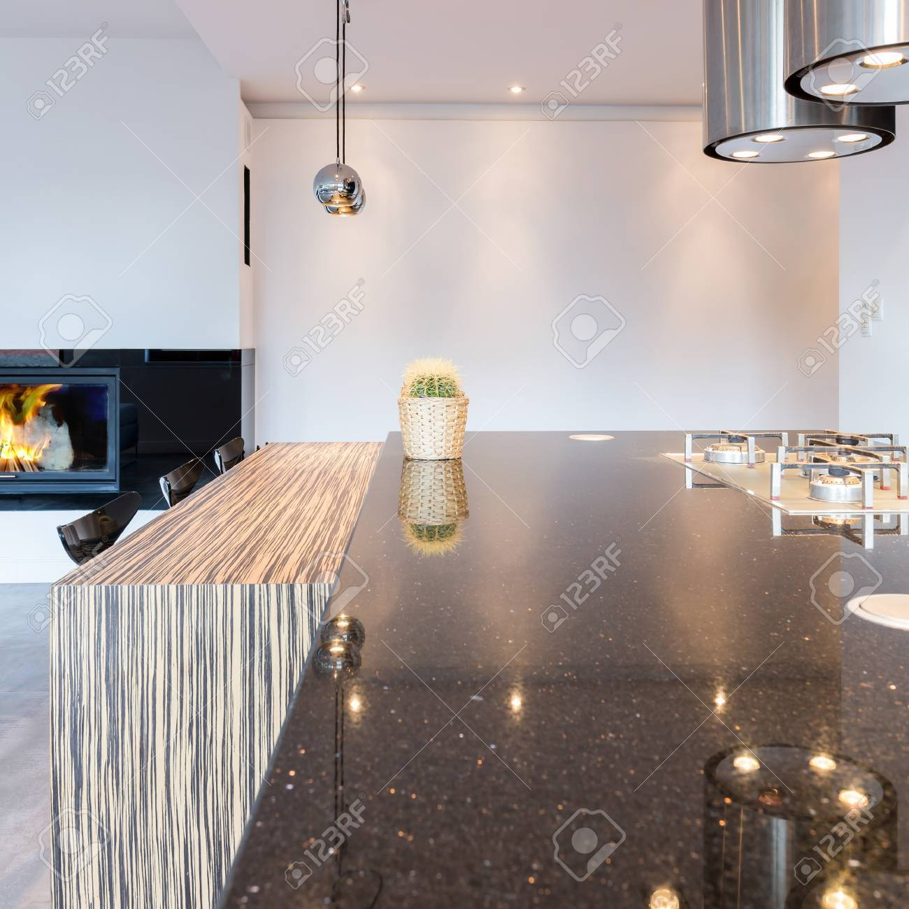 Minimalist Kitchen With Large Countertop Modern Lighting And Stock Photo Picture And Royalty Free Image Image 77349622