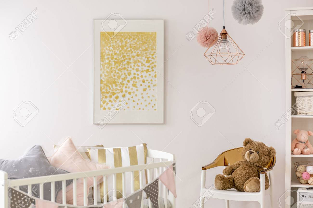 Toddler bedroom with white crib, poster, chair and teddy bear - 77583564