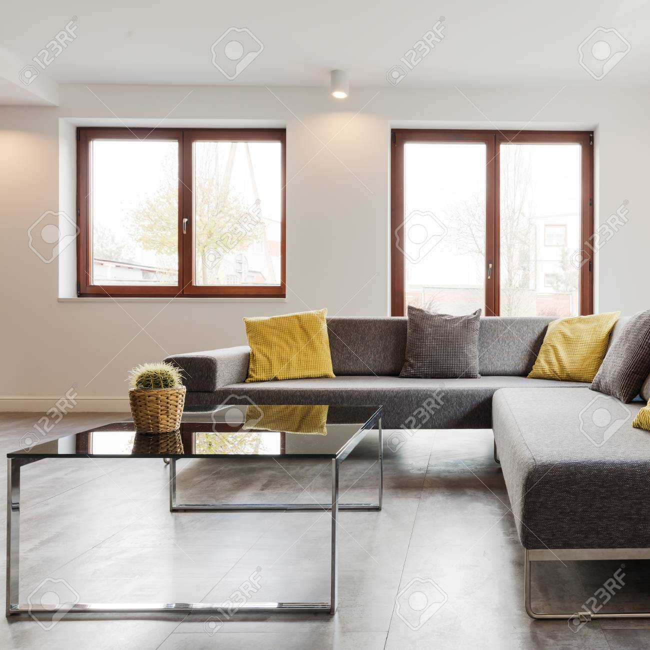 Large Corner Sofa And Glass Coffee Table In A Very Modern And