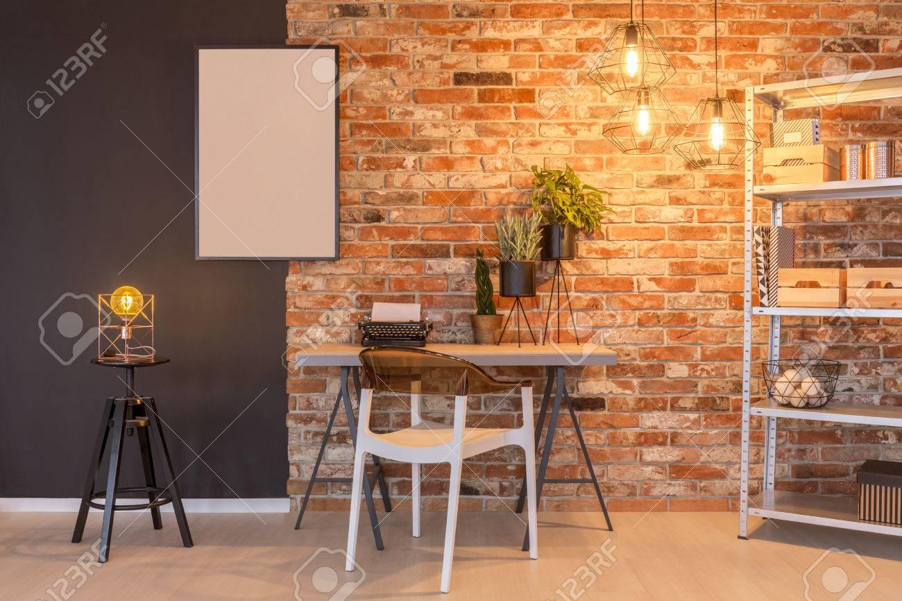Loft Apartment With Brick Wall, Desk, Chair, Chalkboard, Lamp ...