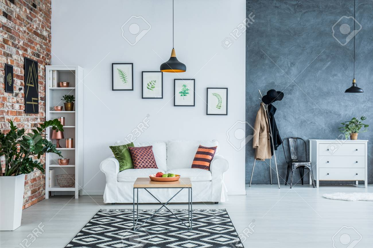 Simple And Cozy White And Copper Living Room With Patterned Carpet Stock  Photo   78749704