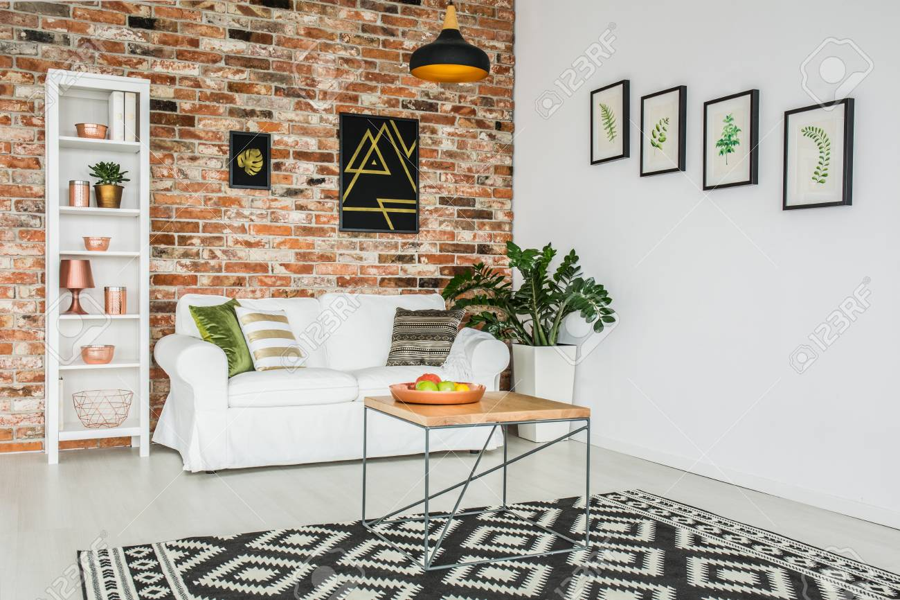 Stylish Cozy Living Room With Red Brick Wall And White Sofa Stock ...