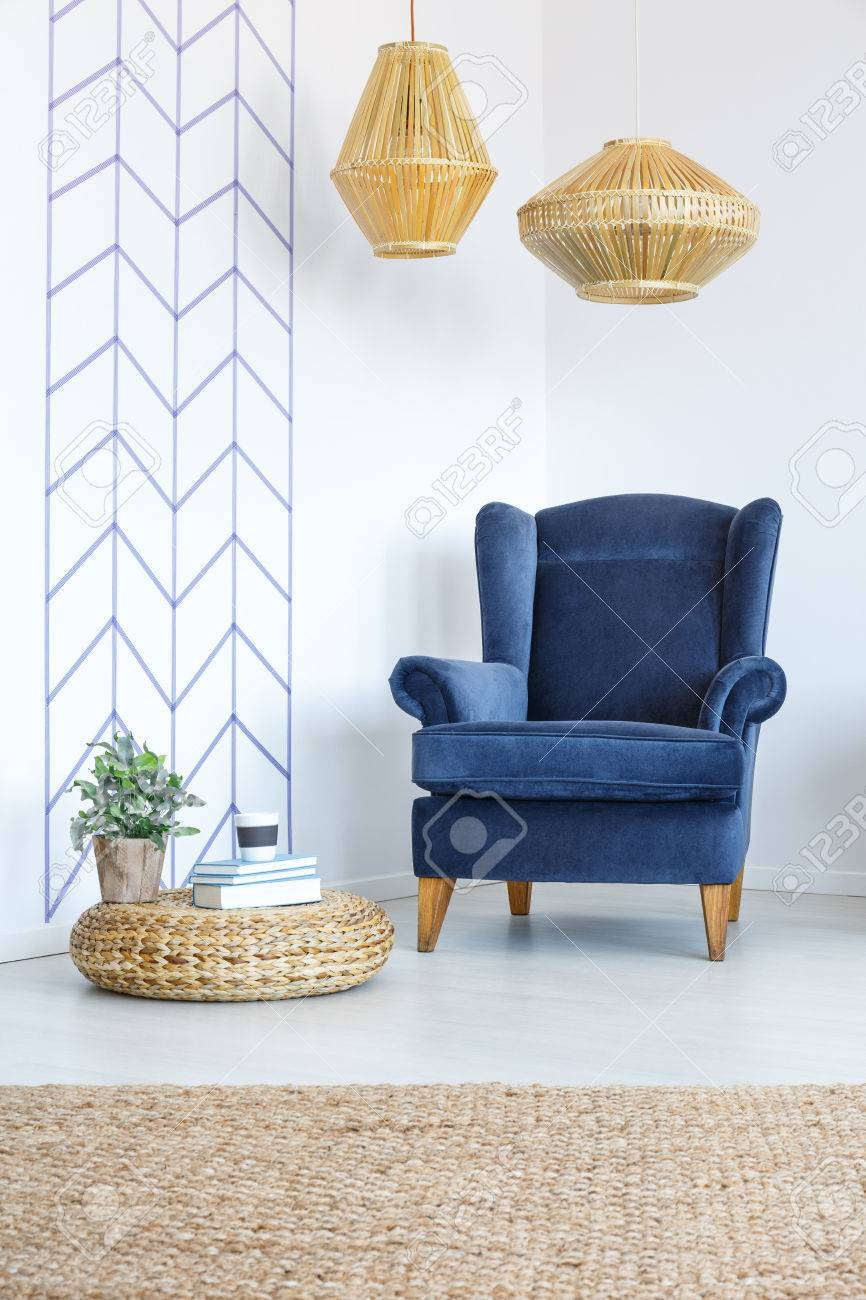 Stock Photo   White Room With Decorative Wall Tape, Blue Armchair, Lamp,  Pouf