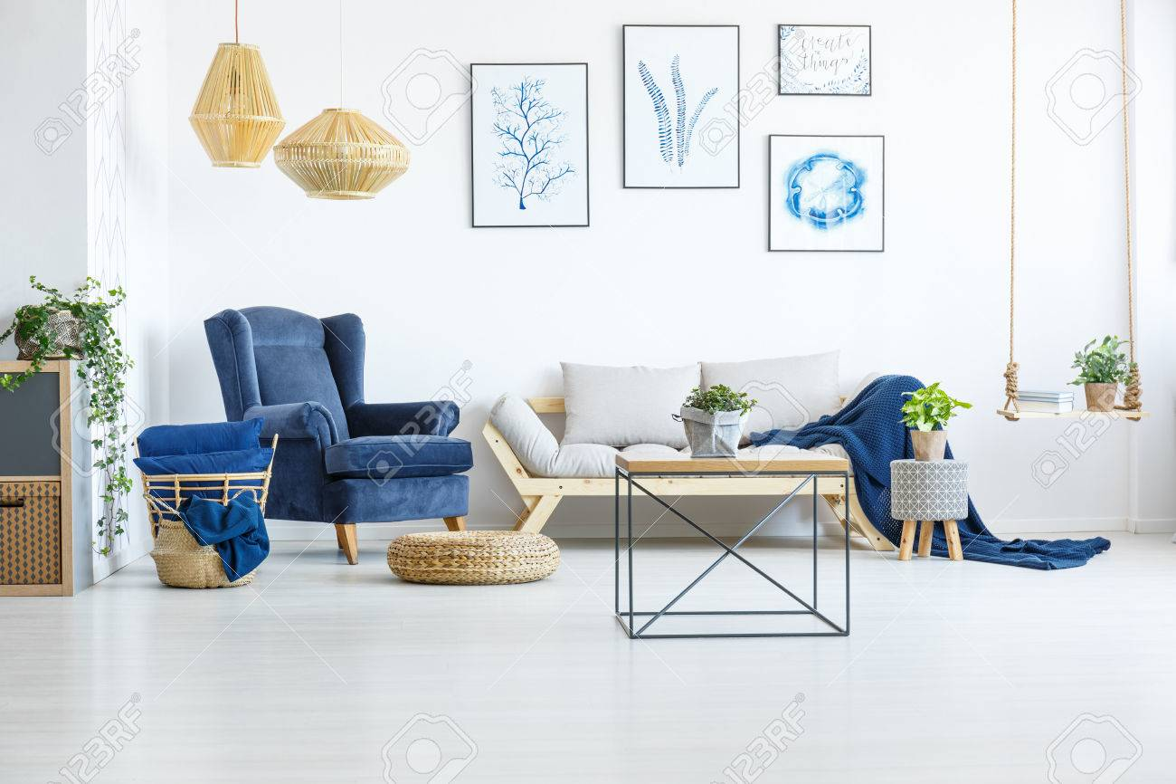 White Living Room Wih Navy Blue Armchair, Sofa And Posters Stock ...