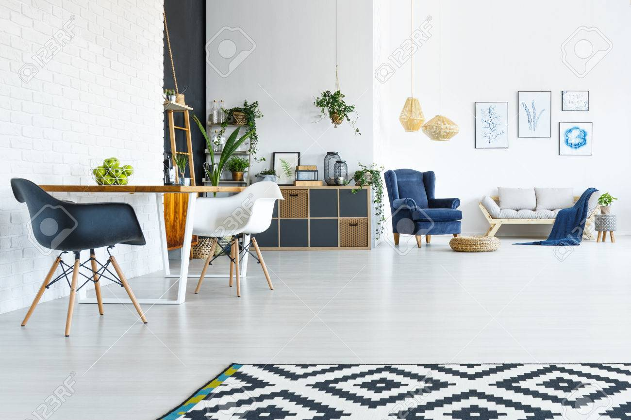 White Apartment With Wood Table, Chairs And Open Living Room Stock ...
