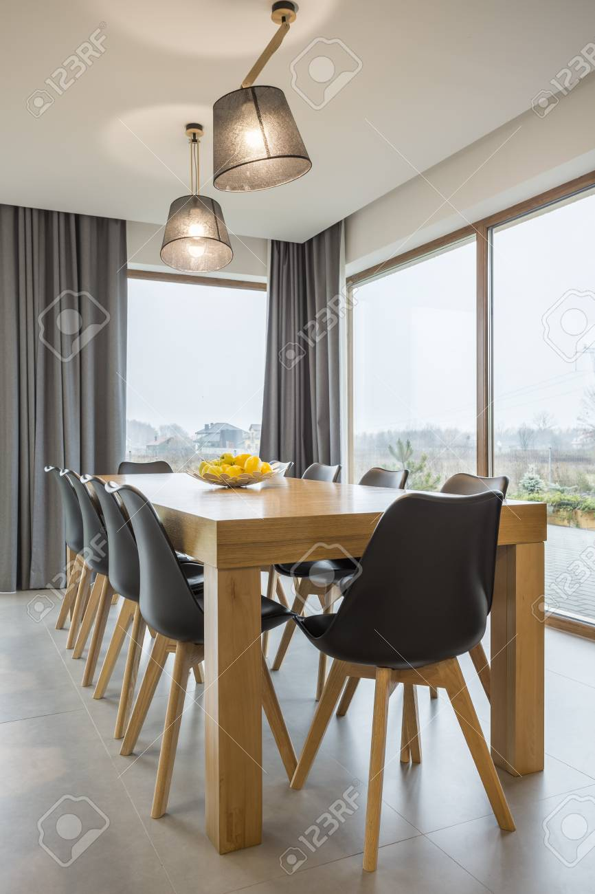 Modern Dining Room With Wooden Table And Big Windows Stock Photo Picture And Royalty Free Image Image 78950088