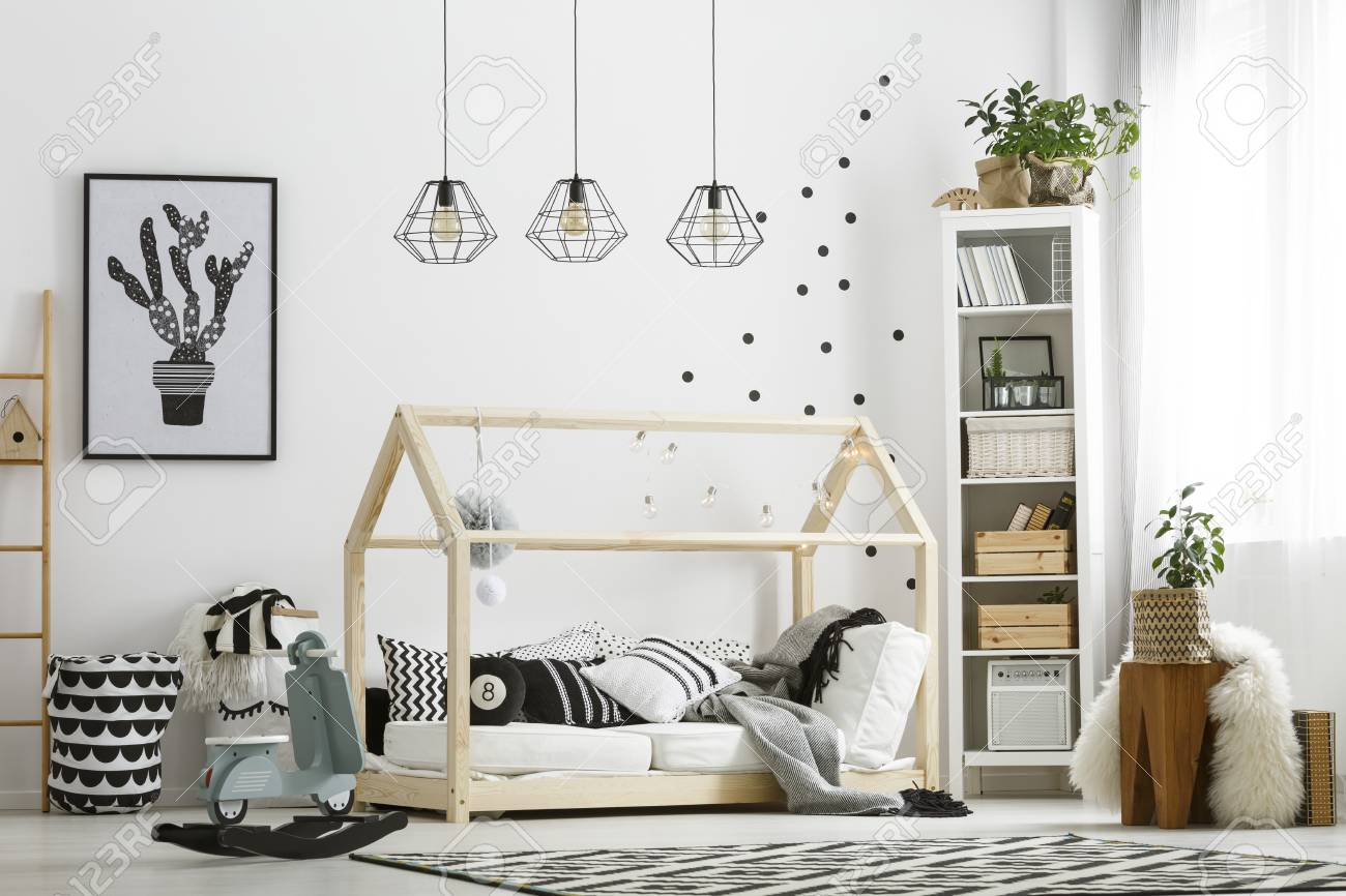 Cozy Wooden Baby Bed In Shape Of Little House With Pillows Stock Photo Picture And Royalty Free Image Image 78949304