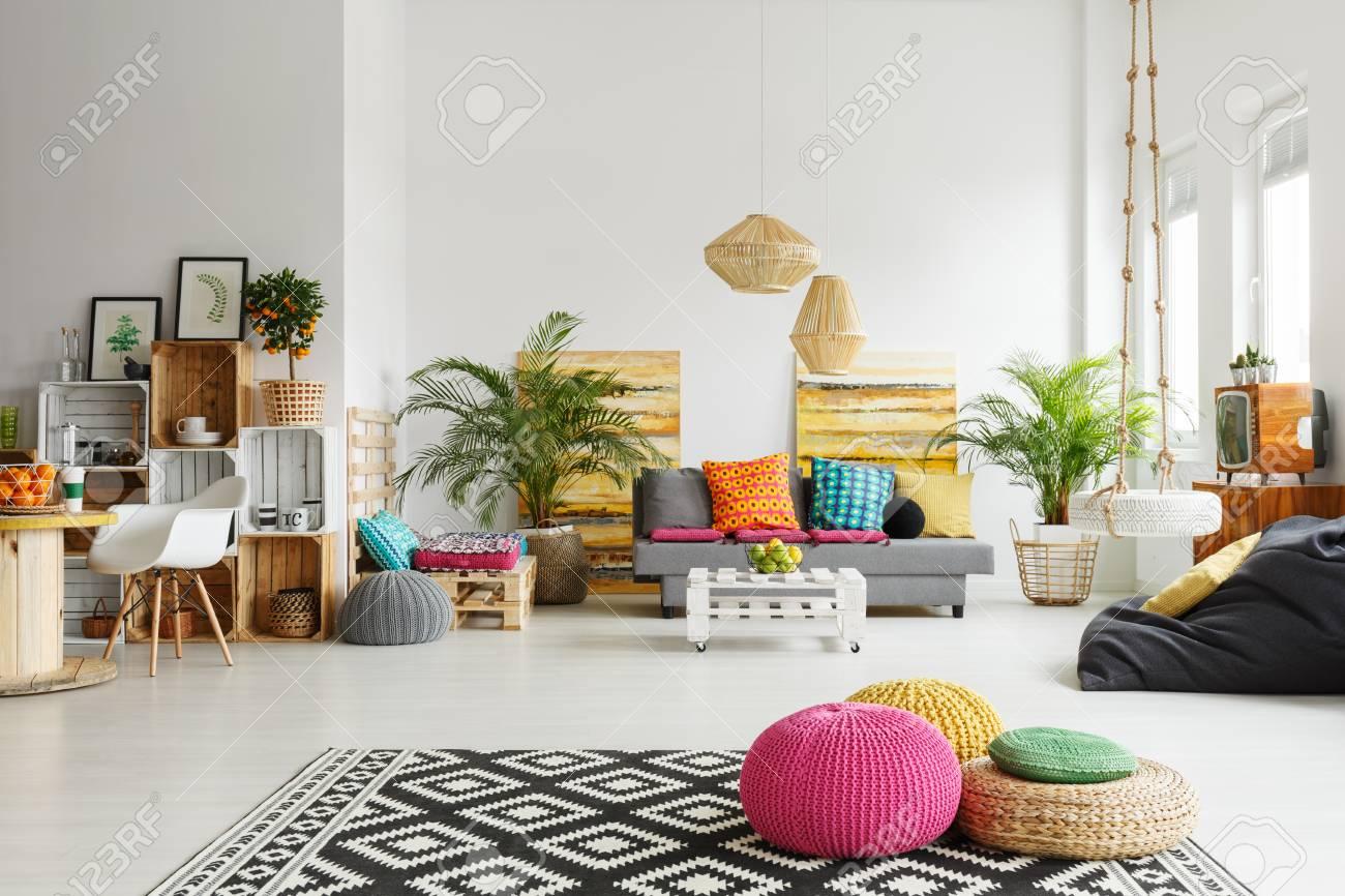 Loft Living Room With Colorful Poufs Sofa Carpet Crate