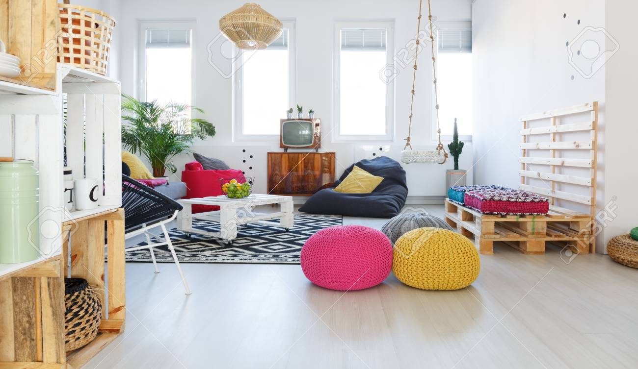 Colorful Retro Living Room With Pouf, Tv, Swing, Crate Furniture Stock  Photo