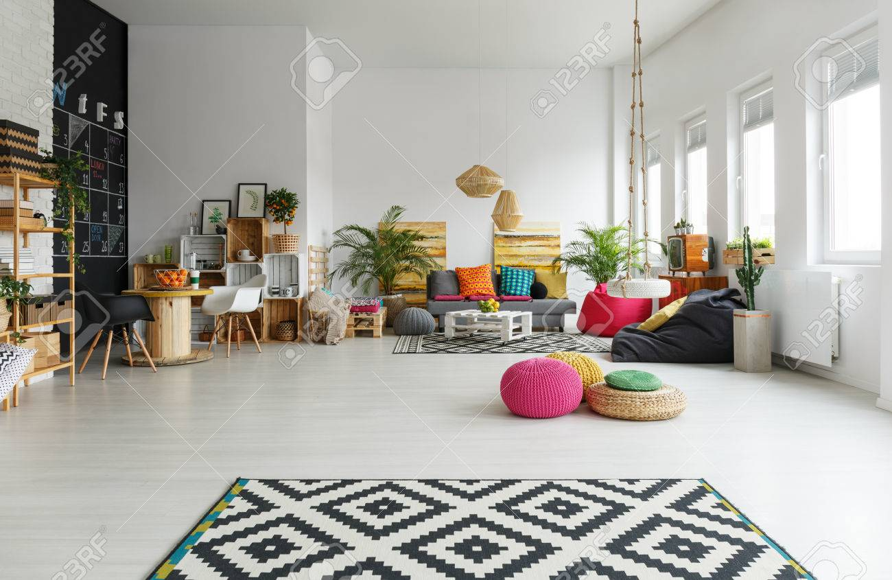 white living room with colorful pouf pattern carpet crate rh 123rf com