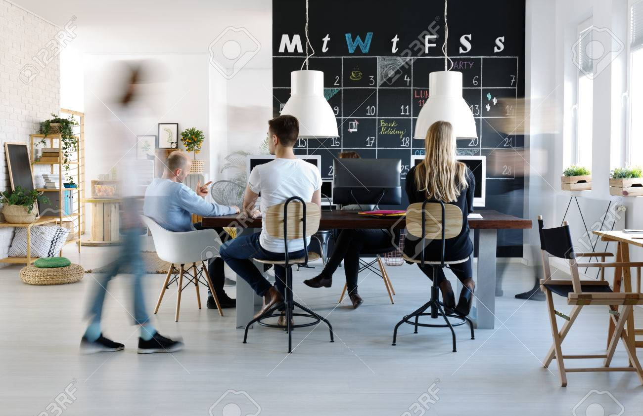 People Working In Modern Creative Work Environment Stock Photo