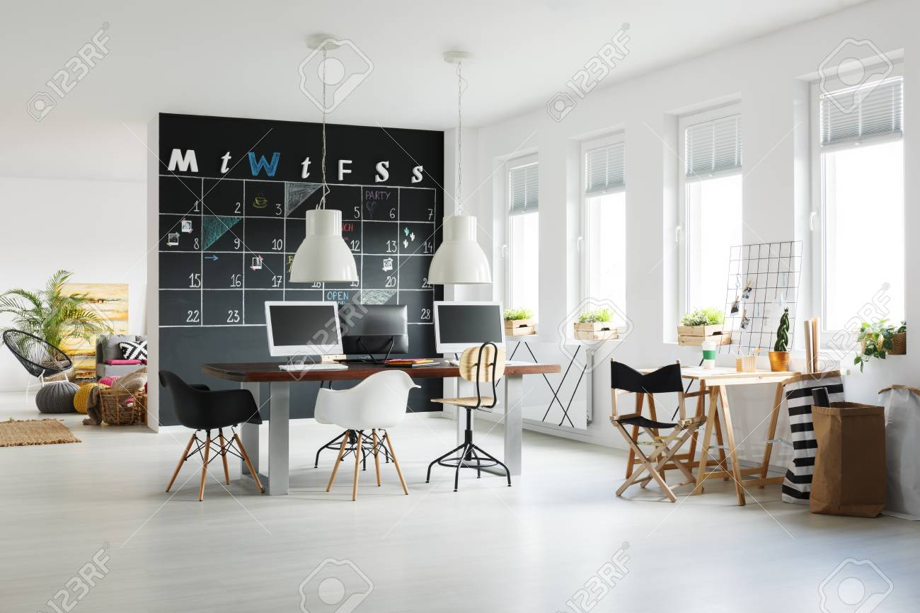 Modern Workspace With Blackboard Calendar, Desk, Chairs And Computers Stock  Photo   79234659