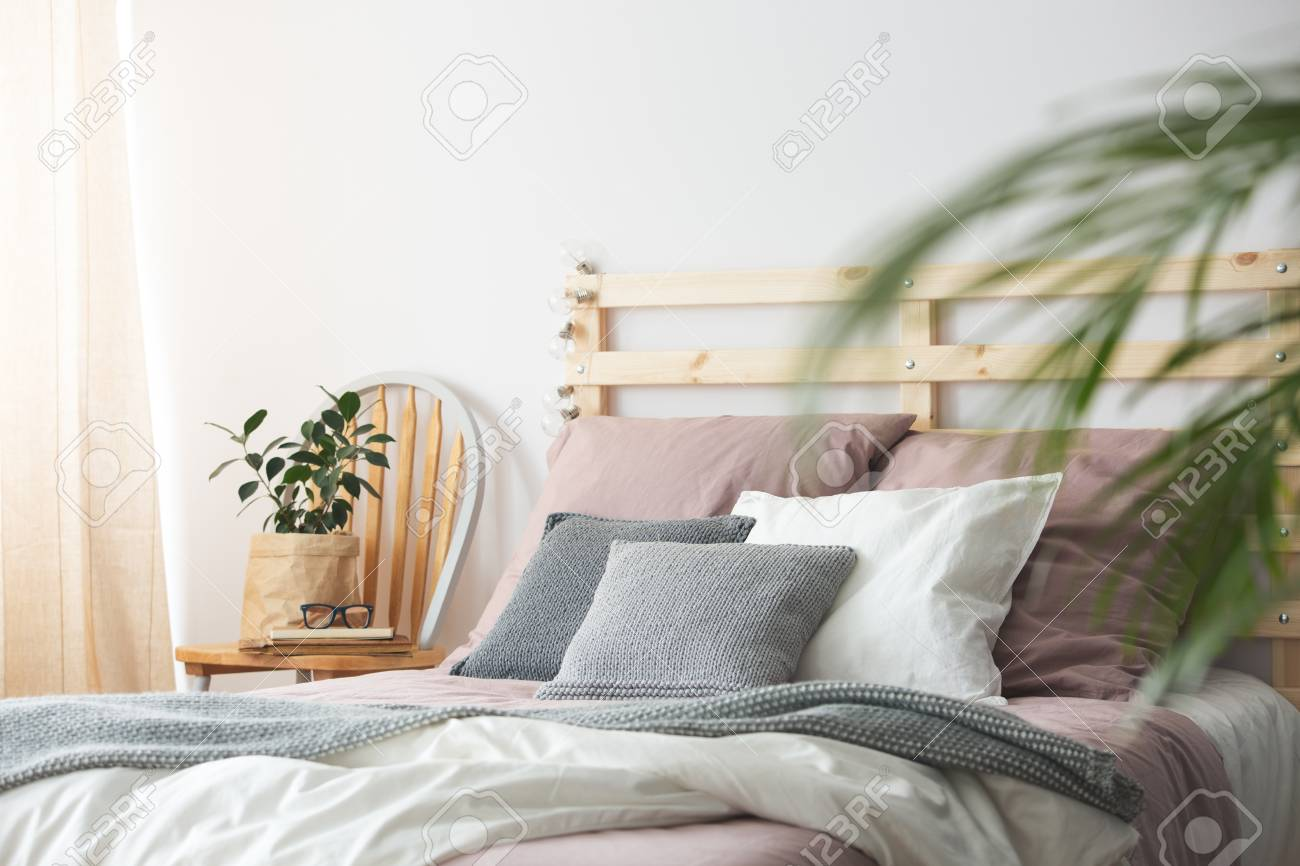 Pink And Grey Cozy Bedding On Wooden Bed In Modern Bedroom Stock Photo Picture And Royalty Free Image Image 79751730
