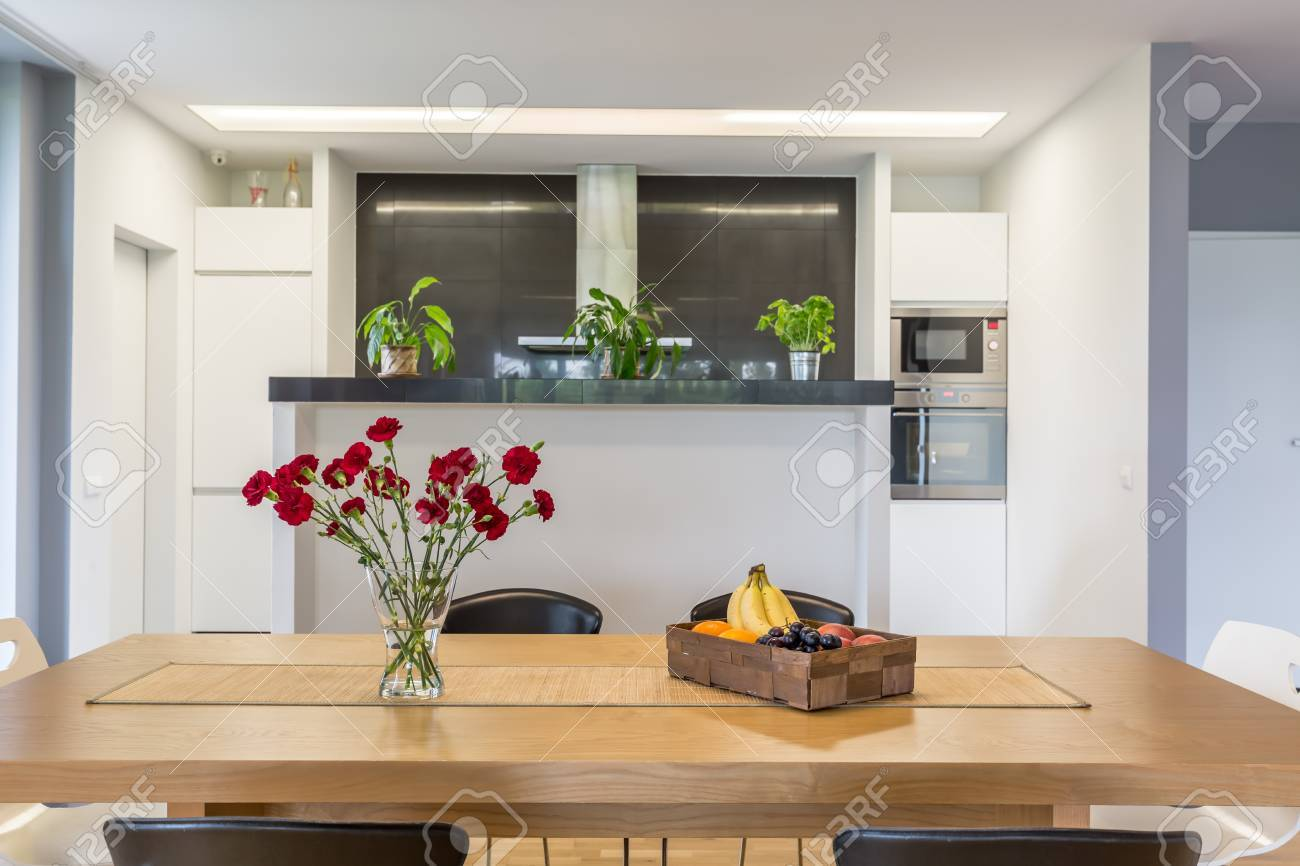 Open Plan Kitchen With The Kitchen Island And Wooden Table At Stock Photo Picture And Royalty Free Image Image 79751864