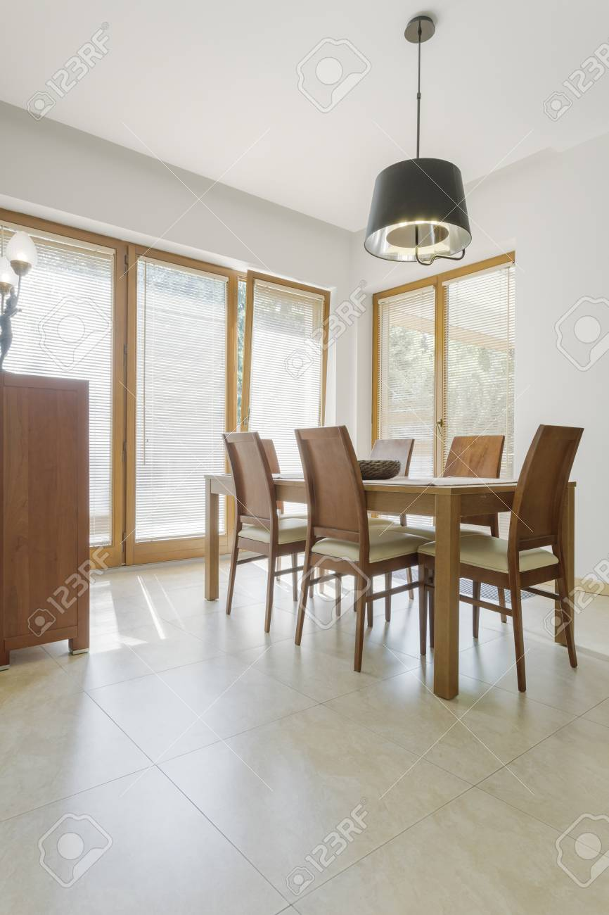 Cozy Dining Area With Wooden Table And Chairs Stock Photo Picture And Royalty Free Image Image 86102817