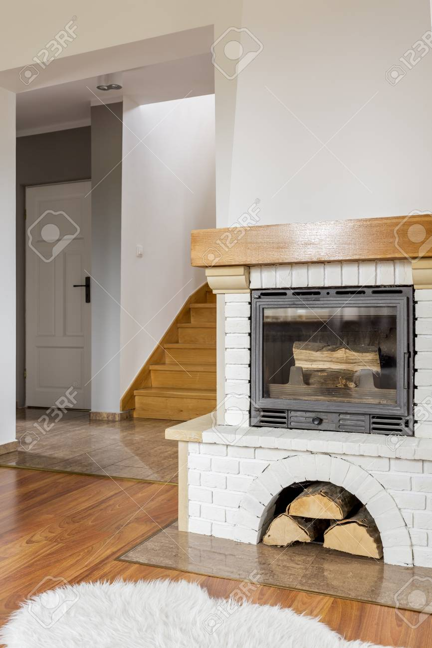 Living Room With Fireplace Staircase And Fluffy Carpet Stock Photo