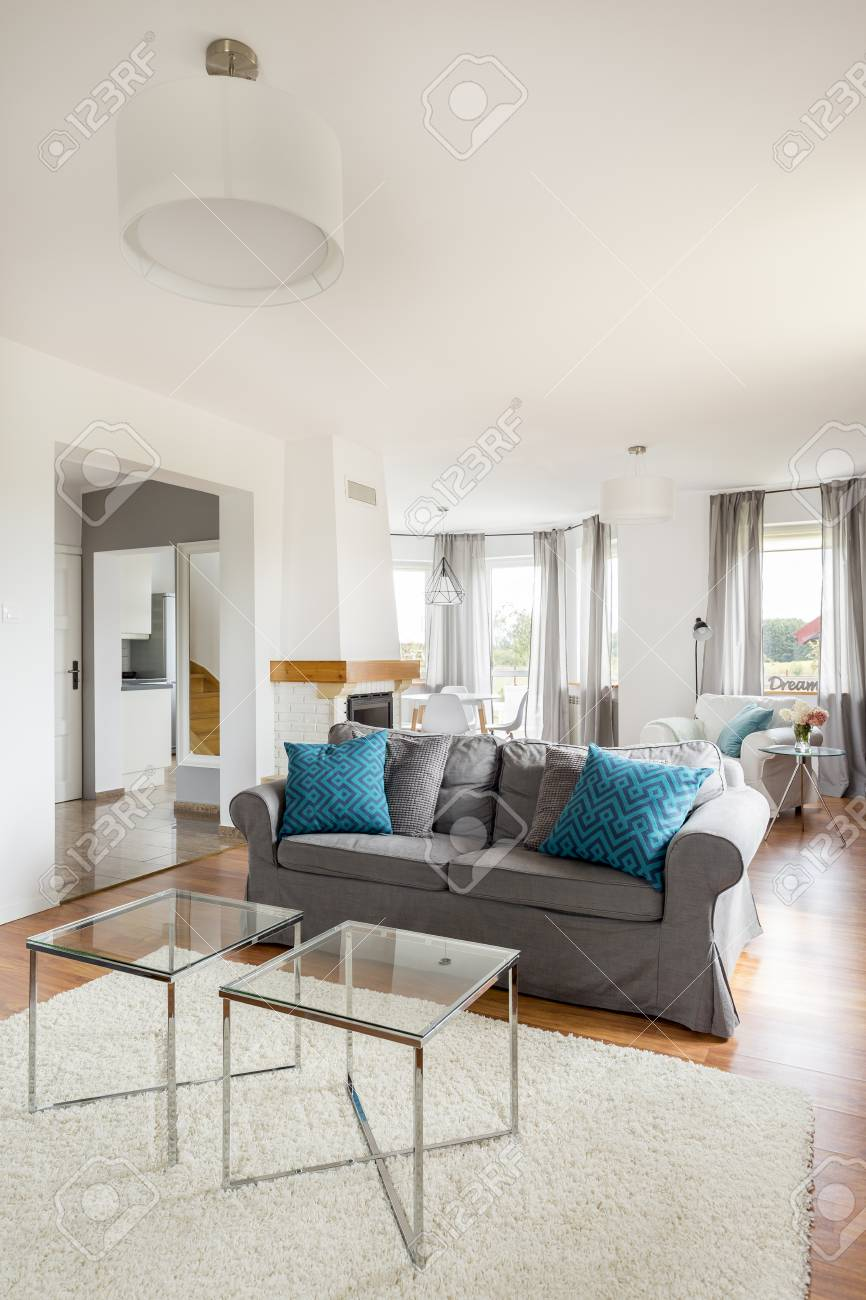 Light And Big Living Room With White Walls And Fluffy Carpet Stock