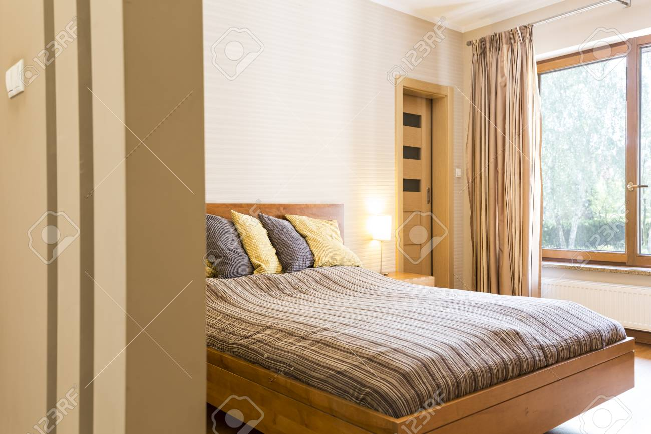 Spacious Master Bedroom With A Double Bed With Pillows And Big Window Stock  Photo   81931431