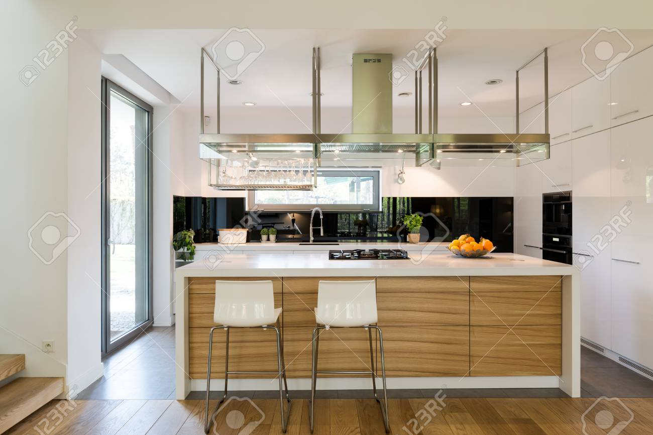Open Plan Of Kitchen Area With A Modern Kitchen Island Chairs