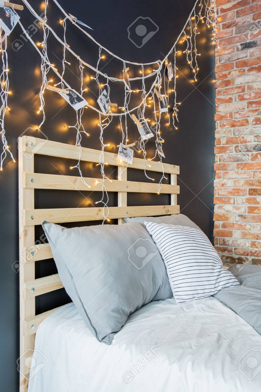 Creative pallet bed headboard with romantic fairy light decoration