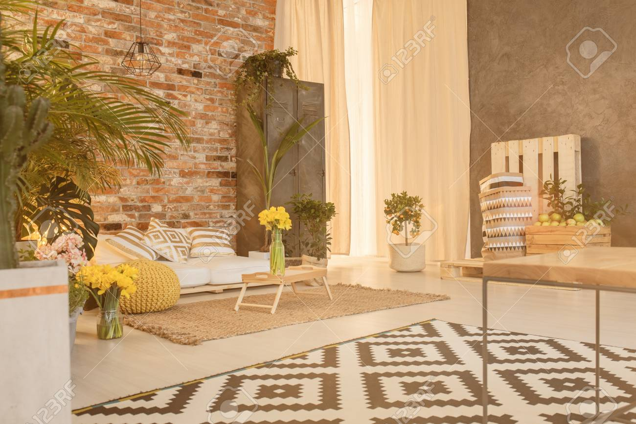 Red Brick Wall In Spacious Living Room With Plants Stock Photo ...