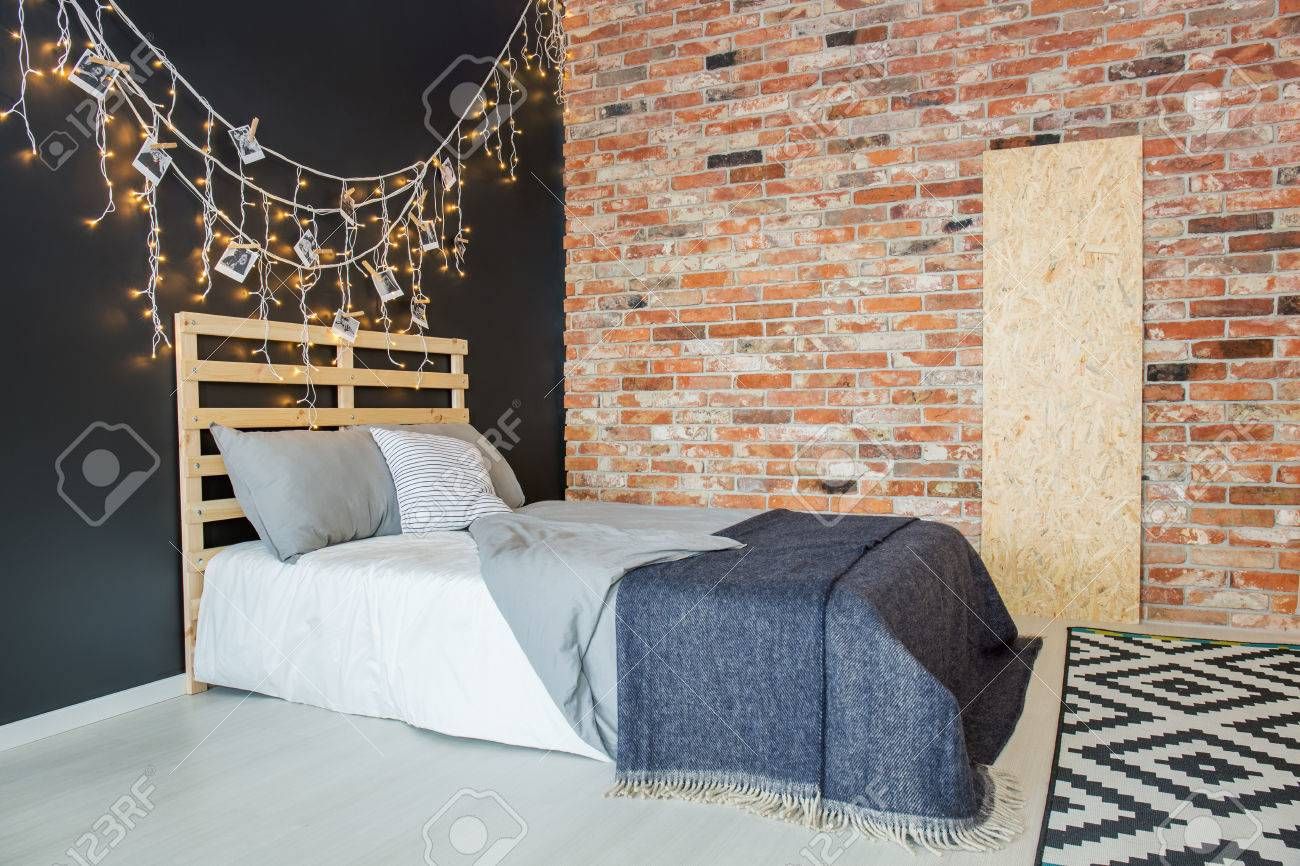 Simple Bed With Diy Headboard In Stylish Minimalist Bedroom With Stock Photo Picture And Royalty Free Image Image 81873570