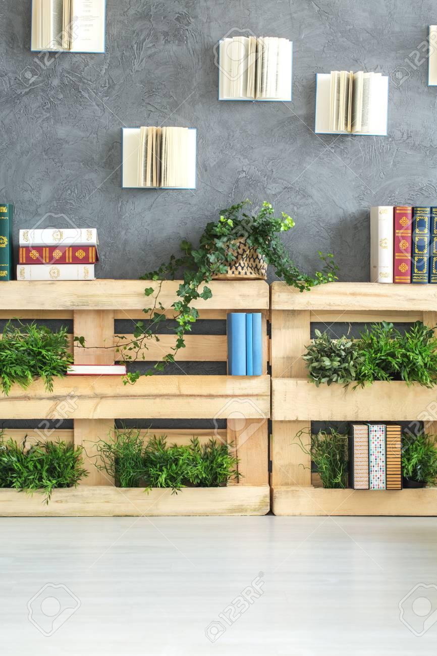 DIY Creative Inspiring Bookshelf Made Of Pallets In Modern Room Stock Photo