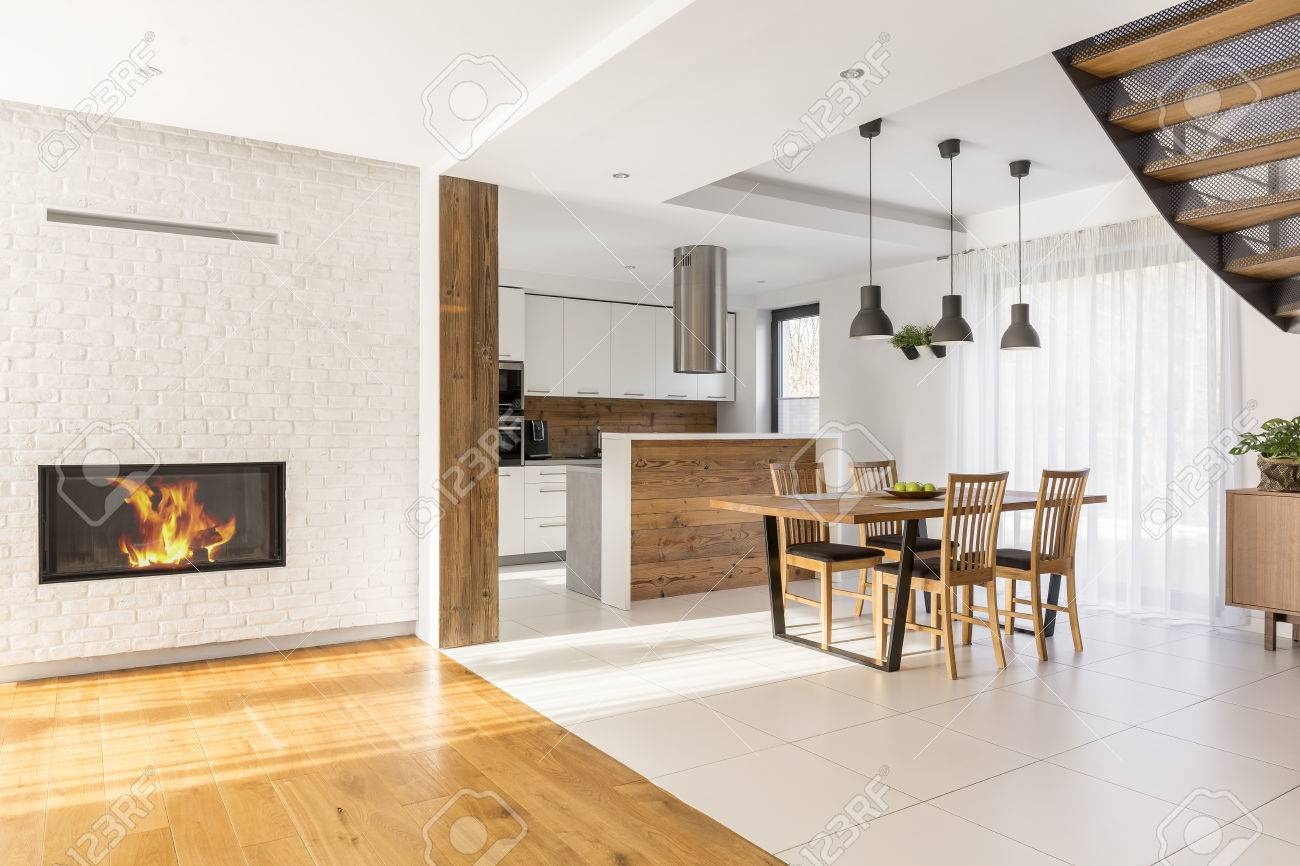 Harmonious Open Space With Fireplace Kitchen And Dining Area Stock Photo